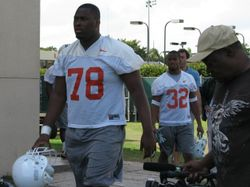 Freshman tackle Jermaine Johnson (wearing 78) and running back Lee Chambers (32) make their way to Greentree practice field Tuesday for the start of spring drills.