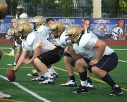 Brandon Linder (right) is the first major recruit UM has been able to land at Aquinas since Leonard Hankerson in 2006.
