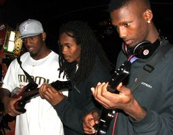 Javarris James (left), Travis Benjamin and Jacory Harris play Guitar Hero Sunday at DisneyQuest.
