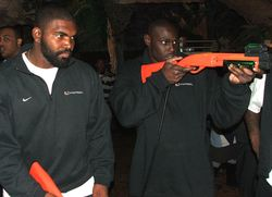 Defensive end Adewale Ojomo (right) plays DinosaurHunter with teammate Richard Gordon (left)