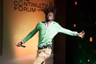 Emmanuel Jal dancing on stage abc Continuity Forum (2)