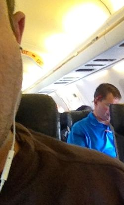 UM coach Al Golden works on his laptop on his flight up to Indy