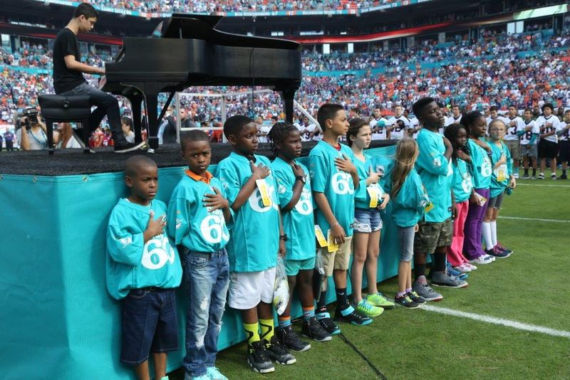 Play_60_group_photo_pregame_during_anthem_with_students_from_Gove_Elementary_(Palm_Beach)_Welleby_Elementary_(Broward)_and_Henry_Reeves_Elementary_(