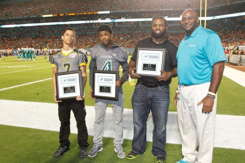 (L-R)_Youth_Player_of_the_Week_RB_K_C__Hall_HS_Player_of_the_Week_QB_Hilton_Joseph_HS_Coach_of_the_Week_Devin_Bush_and_Miami_Dolphins_Youth_Programs