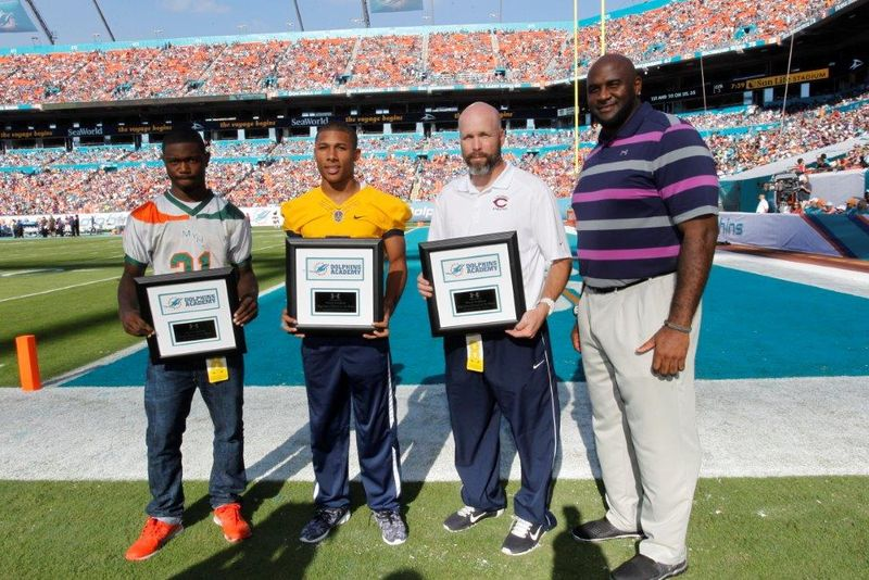 (L-R)_Youth_Player_of_the_Week_Marcus_Barthell_HS_Player_of_the_Week_James_Oliphant_HS_Coach_of_the_Week_Chris_Merritt_and_Miami_Dolphins_Youth_Programs_Manager_Troy_Drayton