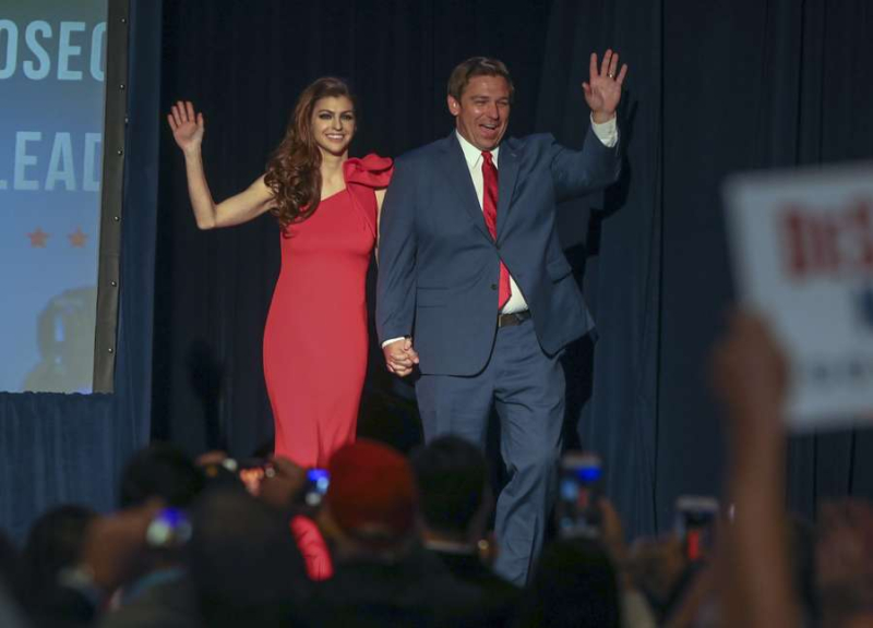 CHRIS URSO | Times Florida Governor elect Ron DeSantis along with his wife Casey wave to the crowd Tuesday, Nov. 6, 2018 in Orlando. DeSantis defeated Democratic candidate Andrew Gillum.