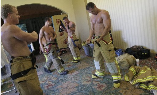1) Firefighters contending for the 2009 calendar pump up before the judging.
